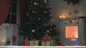 Beautifully decorated Christmas tree sparkling with lights, holiday preparations