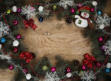 Beautifully decorated Christmas wreath on wooden background Royalty Free Stock Photos