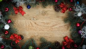 Beautifully decorated Christmas wreath on wooden background. Photo with place for text royalty free stock images