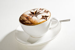 Beautifully decorated cup of hot coffee Stock Photos