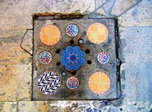 Beautifully decorated drain cover stock photos