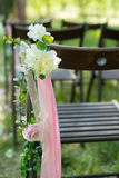 Beautifully decorated with flowers chairs for a wedding reception Royalty Free Stock Photos