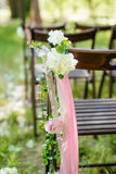Beautifully decorated with flowers chairs for a wedding reception Stock Photo