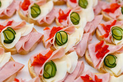 Beautifully decorated,  food snacks and appetizers with sandwich,  on party  or wedding celebration Stock Photography