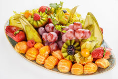 Beautifully decorated fruit platter in a plate on a white background Royalty Free Stock Photos