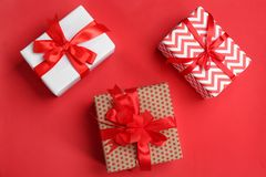 Beautifully decorated gift boxes. On color background, top view Royalty Free Stock Photo