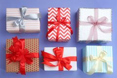 Beautifully decorated gift boxes. On color background, top view Stock Photo