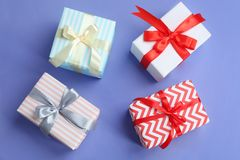 Beautifully decorated gift boxes. On color background, top view Stock Photography