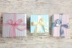 Beautifully decorated gift boxes on wooden background. Top view Royalty Free Stock Photo