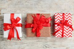 Beautifully decorated gift boxes. On wooden background, top view Royalty Free Stock Photo