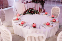 Beautifully decorated guest table, with guest`s names on pomegranate. Beautifully decorated, served guest wedding table, with guest`s names on pomegranate Royalty Free Stock Photo
