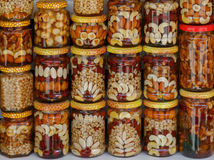 Beautifully decorated jars with honey and nuts as traditional souvenir Royalty Free Stock Image