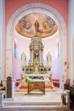 Beautifully decorated the main altar of small church Stock Photos