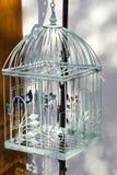Decorative bird cage hanging outside Stock Photo