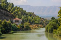 Beautifully decorated ottoman houses of historical white city under fortress along the river. And everyday life of albanian UNESCO world heritage site royalty free stock image