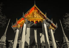 The beautifully decorated pagodas of Wat Pho temple at night. Stock Photos