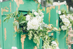 Beautifully decorated photo zona for wedding. Green chest of drawers decorated with white flowers. Beautifully decorated photo zona for a wedding. Green chest of Royalty Free Stock Image