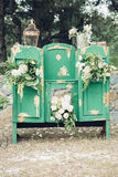 Beautifully decorated photo zona for wedding. Green chest of drawers decorated with white flowers. Beautifully decorated photo zona for a wedding. Green chest of Royalty Free Stock Photography