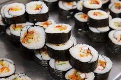 Beautifully decorated sushi on a plate. Many beautifully decorated sushi on a plate Stock Photography