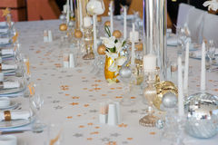 Beautifully decorated table with glass and plate. Beautifully decorated table with crystal candlesticks at wedding reception, selective focus. White tablecloth Royalty Free Stock Image