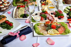 Beautifully decorated table, with meat and fish specialties. Royalty Free Stock Photo