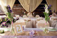 Beautifully decorated table for the wedding ceremony. Served banquet table decorated with fresh flowers in the open air Stock Photo