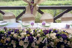Beautifully decorated table for the wedding ceremony. Served banquet table decorated with fresh flowers in the open air Stock Images