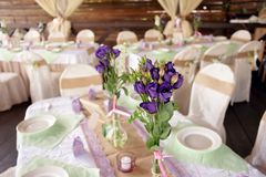 Beautifully decorated table for the wedding ceremony. Served banquet table decorated with fresh flowers in the open air Royalty Free Stock Photos