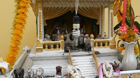 Beautifully decorated traditional Buddhist altar in the garden in Thailand, with flowers and various symbolic figures. Beautifully decorated the traditional stock footage