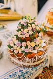 Beautifully decorated traditional wedding bread on altar in easter european church.  Stock Image