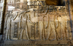 A beautifully decorated wall displaying engravings and hieroglyphs at the Temple of Kom Ombo in Egypt. Stock Photo