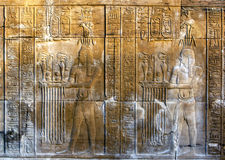A beautifully decorated wall displaying engravings and hieroglyphs at the Temple of Kom Ombo in Egypt. Kom Ombo sits on the banks of the River Nile in southern stock photos