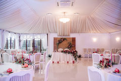Beautifully decorated wedding hall in white and red colours Stock Photo