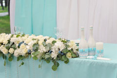 Beautifully decorated wedding table. Beautifully decorated with cloth, flowers and accessory wedding table Royalty Free Stock Photo
