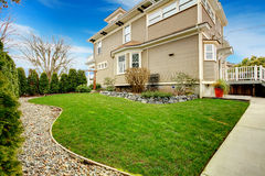 Beautifully designed backyard with green trim  and stoned flower Royalty Free Stock Photos