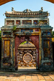 Beautifully designed gate in Hue Imperial Palace. Purple Forbidden City, Vietnam royalty free stock photography