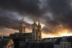Truro Cathedral, Cornwall, England. A beautifully dramatic sunset over the city of truro. the sunlight bursts through the sombre clouds to bath truro cathedral Royalty Free Stock Photos