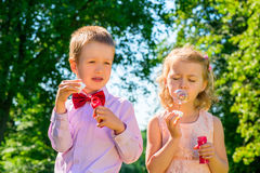 Beautifully dressed kids with soap bubbles Stock Image