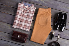 Beautifully folded men's clothing. Beautifully folded men's clothing lying on a wooden floor Royalty Free Stock Images