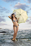Beautifully girl. Sexy slenderness beautifully girl standing on river, outdoor with  sunshade Royalty Free Stock Photos