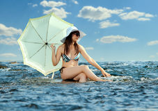 Beautifully girl. Sexy slenderness beautifully girl standing on river, outdoor with  sunshade Stock Images