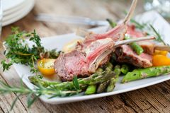 Beautifully grilled lamb rib chop steaks, medium rare . stock photo