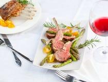 Beautifully grilled lamb rib chop steaks, medium rare . royalty free stock photos