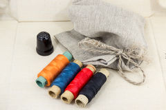 Beautifully laid out accessories for needlework on a fabric background Royalty Free Stock Photo