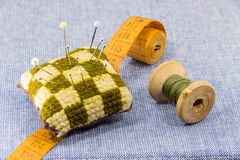 Beautifully laid out accessories for needlework on a jeans background Stock Photos