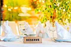 Beautifully laid for supper table with sign reserved Stock Photography