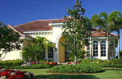 Beautifully Landscaped Home. In the tropics with bright blue sky stock photo