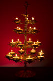 Beautifully Lit Lamp. Photo of a Beautifully Lit Lamp with the Hindu Sacred Symbol Om royalty free stock photos