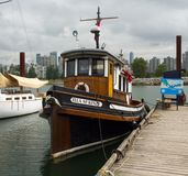 A beautifully maintained classic wooden boat at a dock in britsh columbia. An old harbor vessel lovingly preserved as seen at a ferry jetty in vancouver Stock Photos