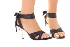 Beautifully manicured feet in sexy shoes Royalty Free Stock Images